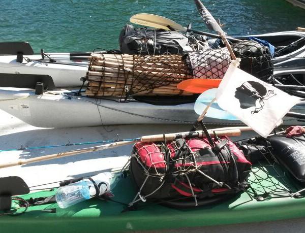 kayaks of guys that were going around Corsica