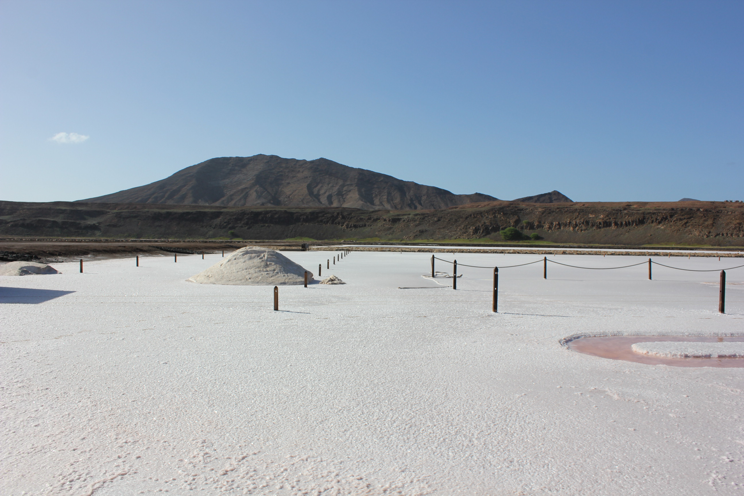 location Salina. this is not snow but salt that dries out on sun, that is why the island is called SAL (salt). the density of salt is around 48%. you can swim in nearby pools